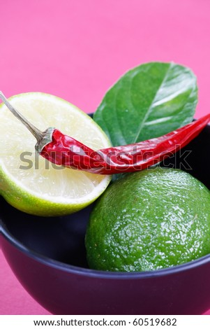 Limes and chilli peppers