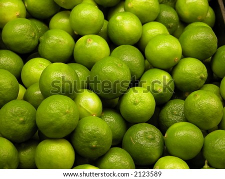 limes in a bin - stock photo