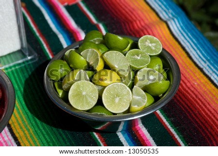 Limes in a Bowl at Taco Stand - stock photo