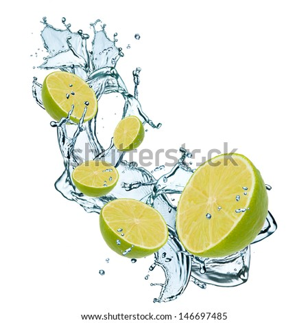 Limes pieces falling in water splash