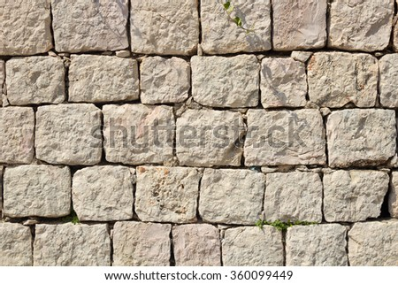 Limestone block wall of old building - stock photo