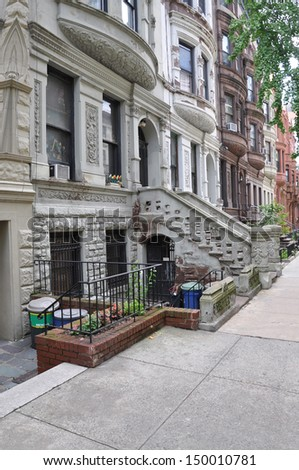 Limestone Brownstone Residential Neighborhood with Recycle Trash Containers - stock photo