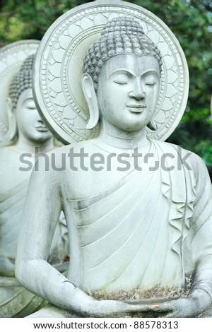 Limestone Buddhist state in Wat Pha Sawang Boon Nakornnayok Thailand - stock photo
