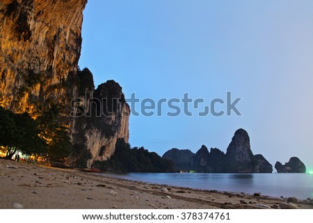 Limestone cliffs of Railay Beach by night in Krabi, Thailand in the evening - stock photo