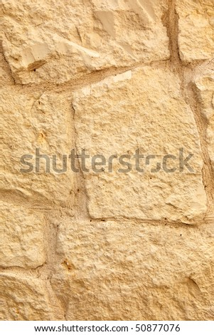 Limestone wall close view with visible texture. - stock photo