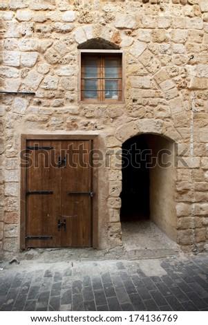 Limestone wall with doors and windows in ancient city Saida, Lebanon - stock photo