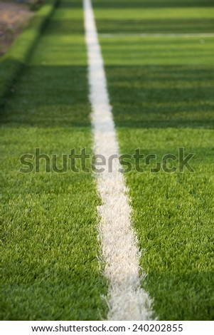 Limit lines of a sports grass field for Background with selective focus - stock photo