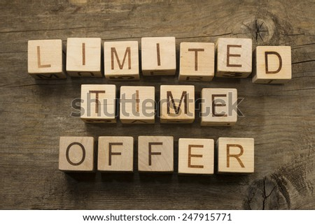 Limited time offer text on wooden cubes - stock photo