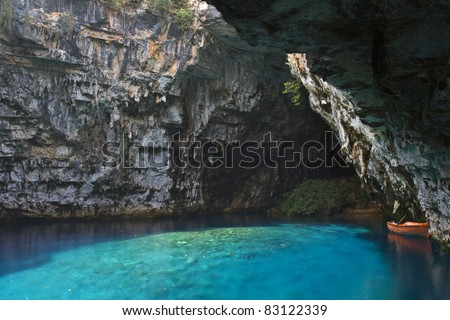 Limnetic cave of Melissani at Kefalonia island in Greece. In ancient years it was a temple of the god 'Panas' and a 'Nymfaion' were the nymphs accompanied Panas