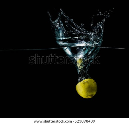 Limon in water splash sparkling, slice, refreshing isolated