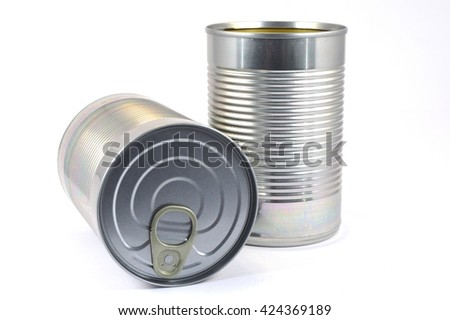 Limp with can of food in standing stainless steel and bedtime on white bottom.