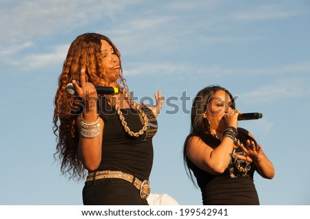 "LINCOLN, CA - June 14: Sandra ""Pepa"" Denton (L) and Cheryl ""Salt"" James of Salt N Pepa perform at Thunder Valley Casino Resort in Lincoln, California on June 14, 2014 - stock photo"