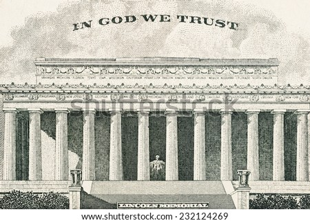 "Lincoln memorial. Close-up of the text ""IN GOD WE TRUST"" American five dollar banknote revers - stock photo"