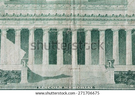 Lincoln Memorial on a United States five dollar note.  Bill is tattered, textured, bent showing years of being handled.  - stock photo