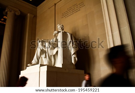 Lincoln Memorial Statue. The famous Lincoln Memorial Statue shot in long exposure with the quote visible above and blurred tourists.