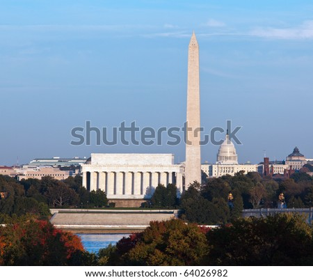 Lincoln Memorial, Washington Monument and Capitol building aligned as the sun starts to set in the fall - stock photo
