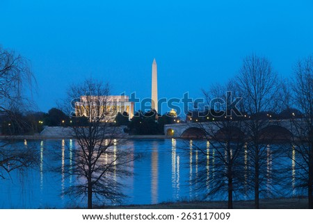 Lincoln Memorial, Washington National Monument and US Capitol Building after sunset. The night view of the main landmarks across Potomac River in Washington DC. - stock photo