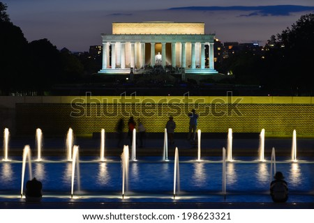 Lincoln Memorial with World War II Memorial foreground at night - stock photo
