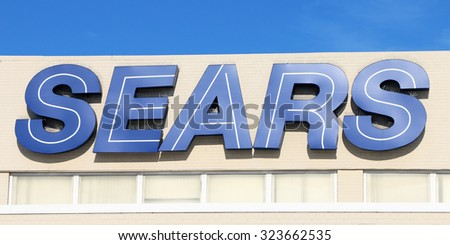 LINCOLN PARK, MI-OCTOBER, 2015:  Sign on the front of a sears store in the midwest.  Sears has been a successful retailer for over 100 years. - stock photo
