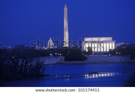 Lincoln & Washington Monuments & U.S. Capitol, Washington D.C. from Arlington, Virginia at dusk - stock photo