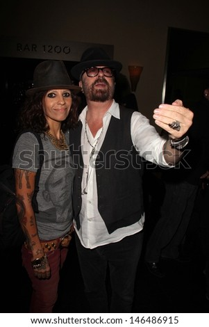 Linda Perry and Dave Stewart at Dave Stewart: Jumpin' Jack Flash & The Suicide Blonde Photography Exhibit, Morrison Hotel Gallery, West Hollywood, CA 07-12-13