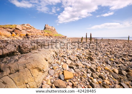 Lindisfarne Castle from beach - stock photo