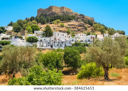 Lindos town and Acropolis. Rhodes, Dodecanese islands, Greece, Europe - stock photo