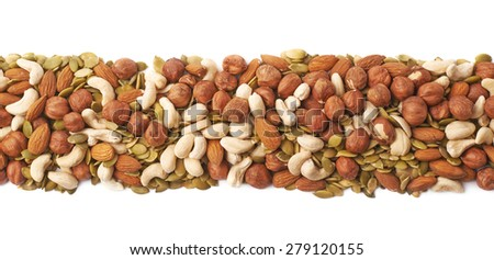 Line border made of multiple different nuts and seed mix, composition isolated over the white background - stock photo