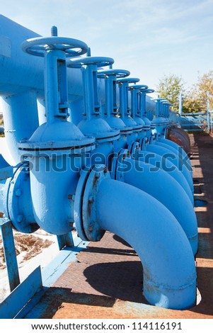 Line from blue oxygen gate valves with pipes on maintenance platform - stock photo