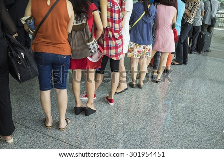 Line of airline Asian passenger waiting at boarding gate - stock photo