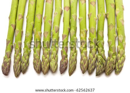 Line of Asparagus spears from above isolated against white. - stock photo