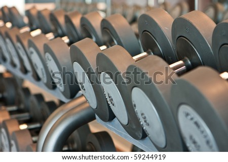 Line of barbells - fitness centre - stock photo