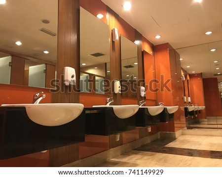 Line of basin bowls at toilet