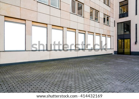 Line of blank vertical mockups of light boxes in a city space. Perspective view