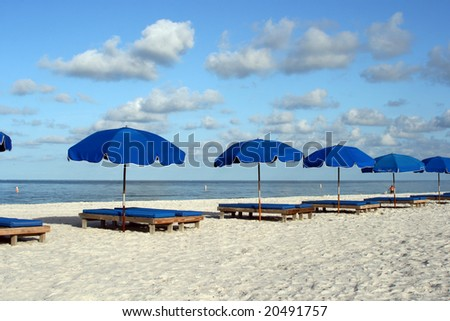 Line of Blue beach chairs on Florida's Gulf Coast. - stock photo