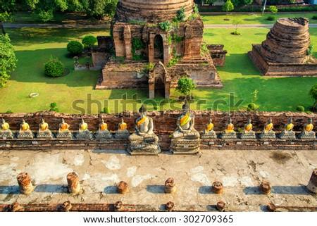 line of buddha statue in wat yai chaimongkol , ayutthaya , Thailand - stock photo