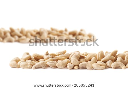 Line of cashew nuts isolated over the white as a copyspace background composition - stock photo