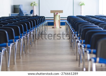 Line of Chairs in the Empty Auditorium Arranged in Two Sections. Horizontal Image - stock photo