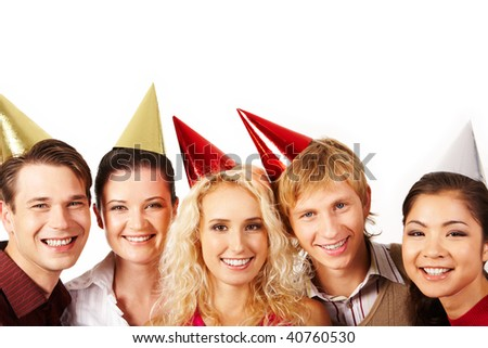 Line of cheerful friends looking at camera with smiles on white background - stock photo