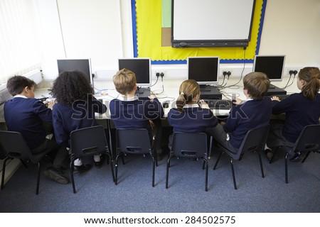 Line Of Children In School Computer Class - stock photo