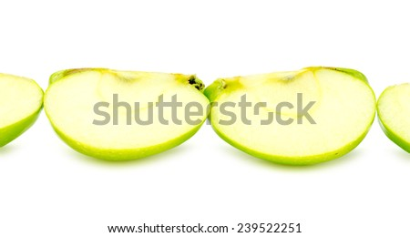 Line of chopped pieces of green apple - stock photo
