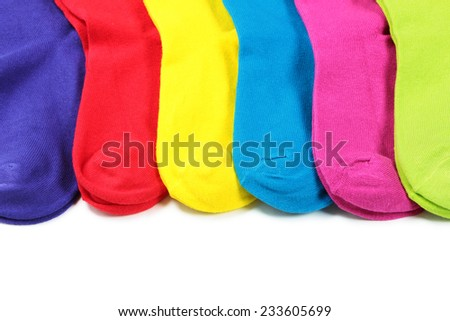 Line of colorful socks on white background - stock photo