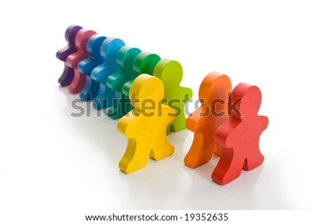 Line of colorful wooden people - one yellow person stand out of line. Isolated on a white background.