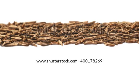 Line of cumin seeds isolated - stock photo