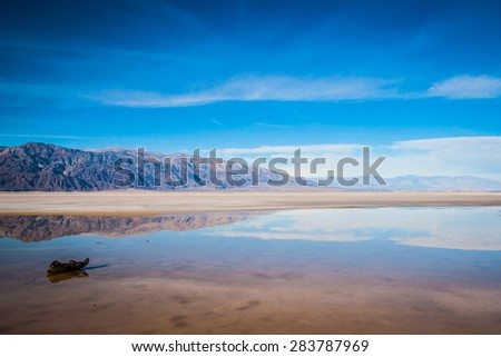 Line of desert mountains stretches into the distance. - stock photo