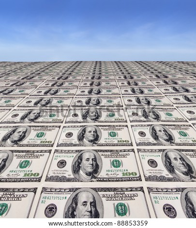 Line of dollar bills with a sky background - stock photo