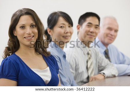 Line of four smiling businesspeople