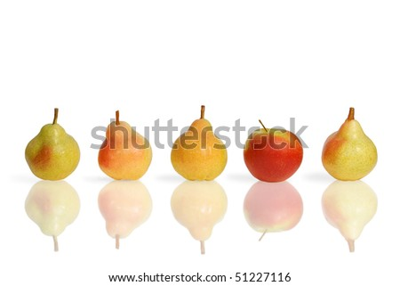 Line of fruits - pears and apple on white background with reflection. Make a choice. - stock photo