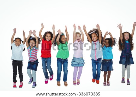 Line of girls standing with arms raised against a white background
