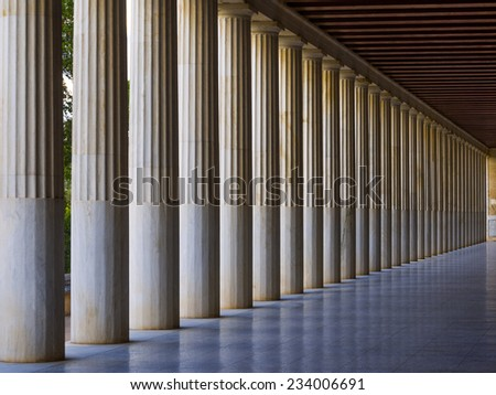 Line of Greek-style columns in the Agora, Athens, Greece  - stock photo
